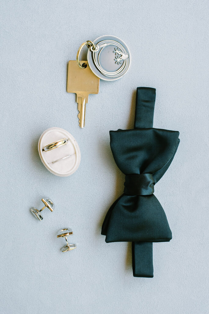 The Lodge at Blue Sky, June wedding, Utah wedding, blue and navy color scheme, groom's rings, cufflinks, and bowtie