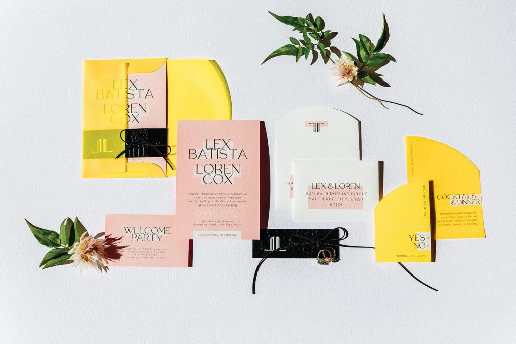 Yellow and pink invitations by Twelve30 Creative. Photo by Michael Cozzens.